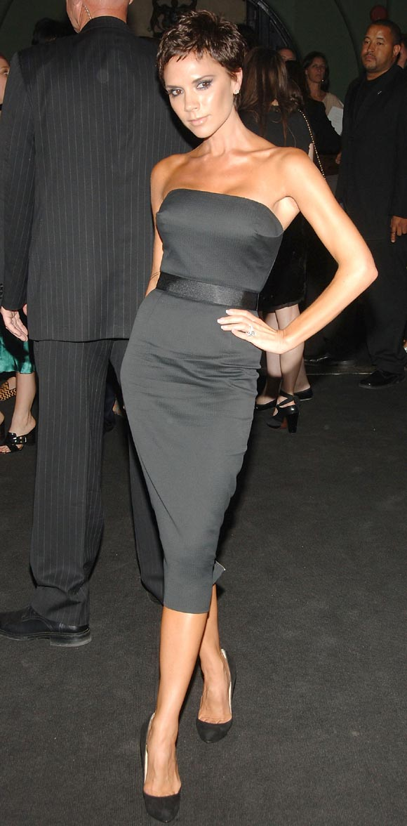 Victoria beckham modeling one of her dvb dress designs on sale this
