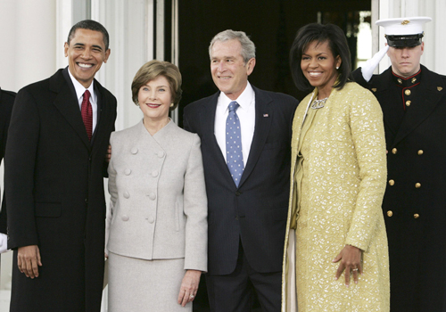 Wife swap? New President and Former President (and a sharply-dressed marine) with the wrong First Ladies, all smiles
