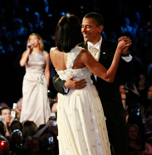 """President Barack Obama dances with First Lady Michelle Obama as Beyonce sings """"At Last"""""""