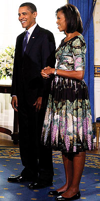 Michelle Obama wears Tracy Feith as she and husband President Obama welcome visitors to the White House on their first day