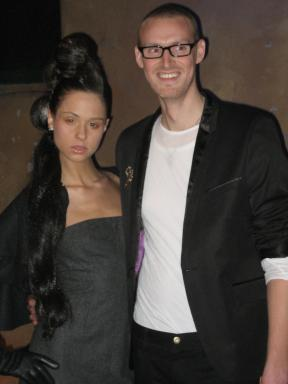 Fashion designer David C. Wigley with a model wearing his first collection, titled Worth
