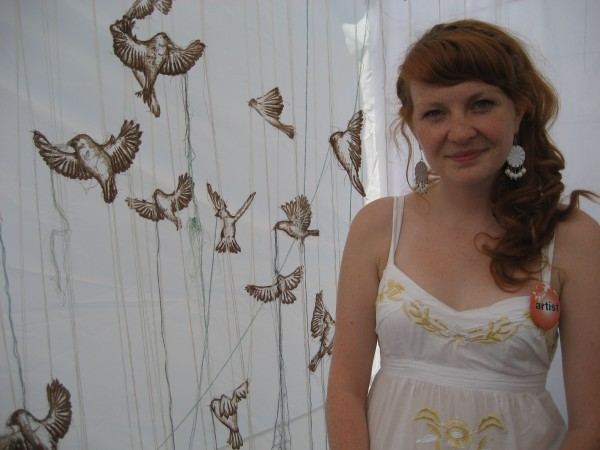 Fibre artist Amanda McCavour stands next to her intallation which won an Honourable Mention Award at the Toronto Outdoor Art Exhibition 2009