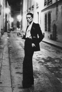 """Photo by Helmut Newton (1975) of YSL's """"Le Smoking"""" tuxedo suit"""