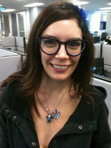 Wearing the beetle with a pendant flower from the same Swarovski spring collection