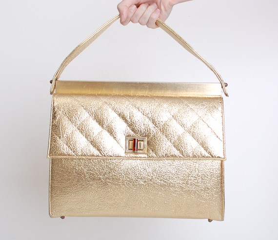 Vintage 1960's quilted gold tote, $118 at Twin Hearts Vintage