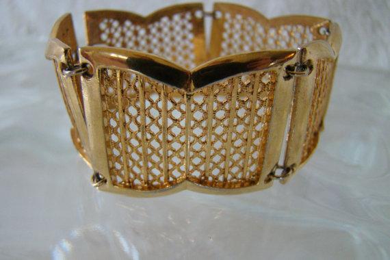 Gold tone vintage '60s art deco style cuff bracelet, $20 at MyLadyJanes