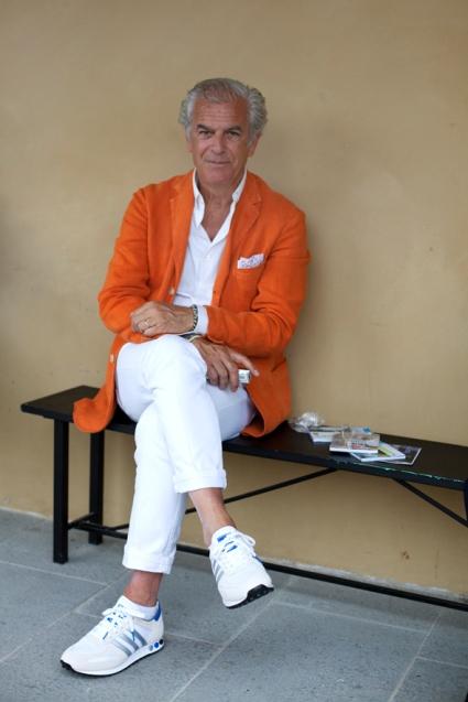 Menswear: white and orange. Via The Sartorialist.