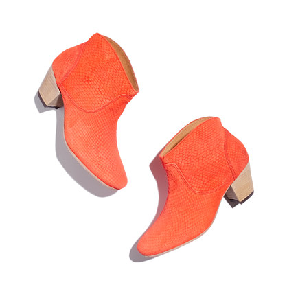 Fantastically fun orange leather booties by Madewell will be the life of the party - provided it's not a lame one where you're expected to drop the heels at the door